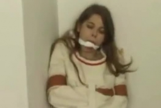 Gagged Brunette Is Sucking Her Partner's Thick Cock While He Is Rubbing Her Tits
